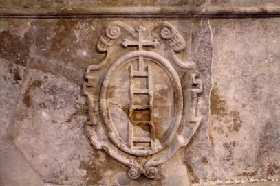 El escudo distintivo de Scala Dei