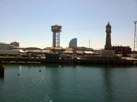 La Torre de Sant Sebastià, Hotel Wella y la Torre del Reloj antiguo faro
