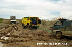 Mitsubishi anchoring a Land Rover to take out of the mud the Unimog at Sibiloi National Park, Kenya