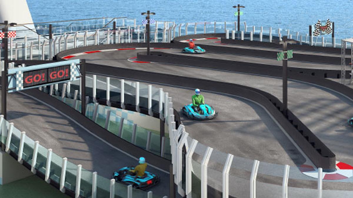 Circuito Karts : Los hombres jóvenes conducir karts en el interior del circuito de