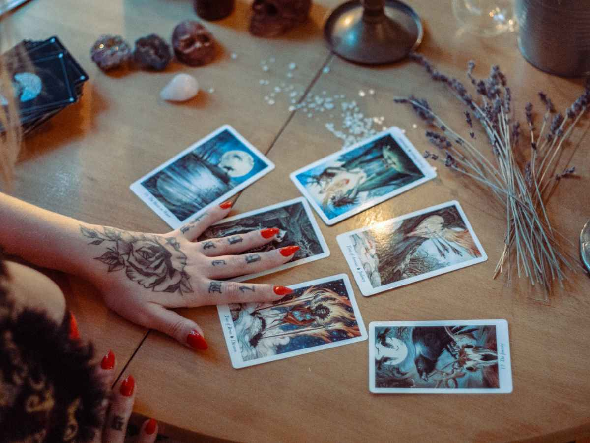 assorted tarot cards on table