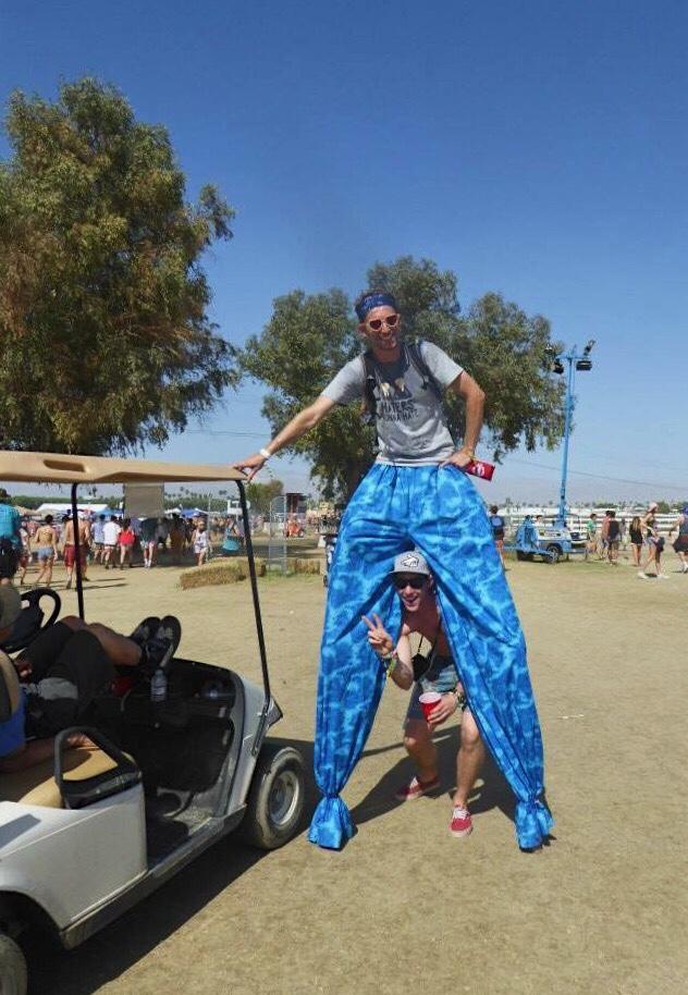 Car Camping Coachella with man on stilts
