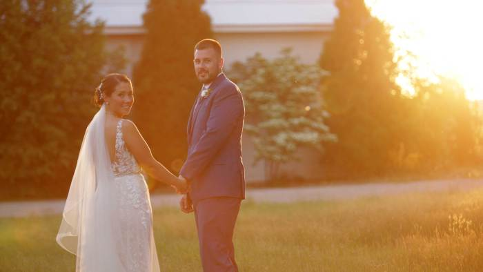 Beautiful wedding day celebration at St. Joe Farm in Granger, IN. Celebrate their wedding day with them by watching this wedding film!