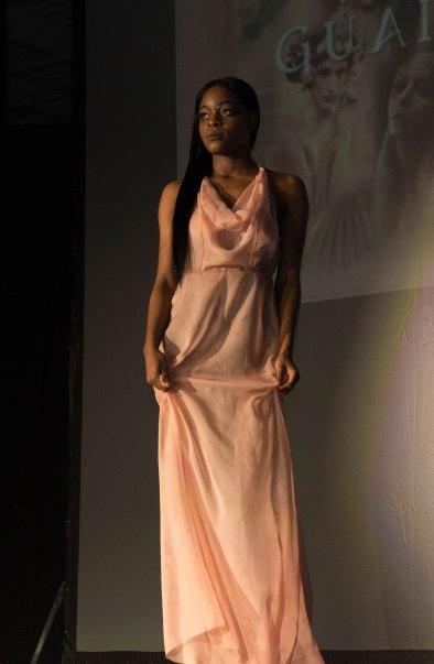 Eternal Divinity by Edanna Guaimano: Virginity and Purity are concepts for lesser men: sexuality can be untainted as well in this cosmic salmon gown of space, wind and acceptance.
