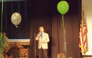 "Joe Rykert dynamically opens the ceremony with ""Climb Every Mountain!"""