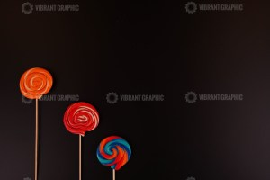 Colorful lollipops on black background