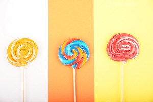 Sweet lollipops on colorful background