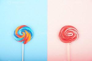 Sweet lollipops on pastel background