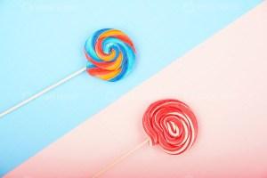 Swirl lollipops on pastel background