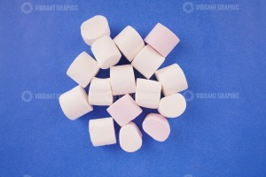 White marshmallow on blue background