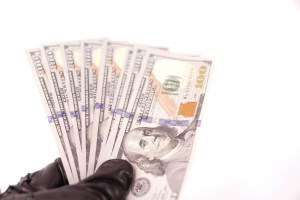 Crime Concept Black Leather Gloves Holding Dollars