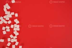 Cube sugar on red stock image