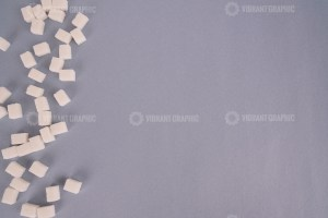 Sugar cubes on grey background stock photo