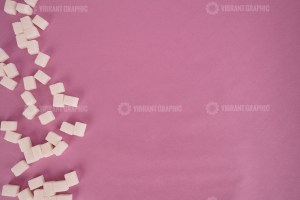 Sugar cubes on rose background stock photo