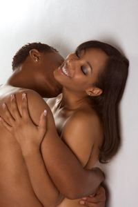 Young couple naked Man and woman in love kissing