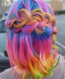 Rainbow hair color with loose braid hairstyle
