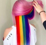 Pink hair with rainbow highlights