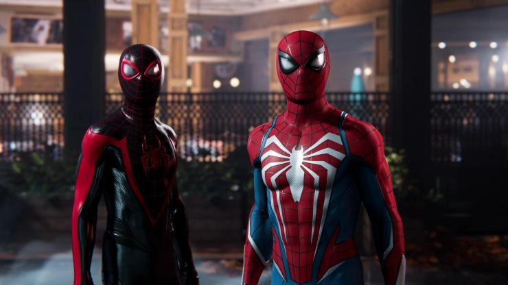 Peter Parker e Miles Morales juntos contra Venom em Spider-Man 2.