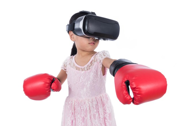 Asian Chinese little girl experiencing virtual reality with boxi