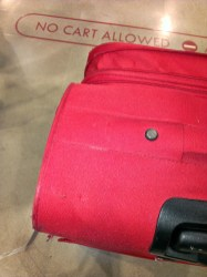 My damaged red suitcase