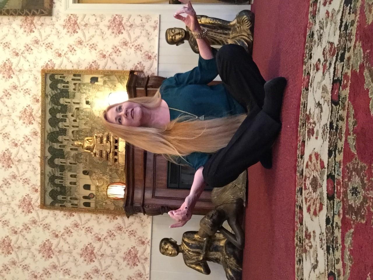 Vickie Gay psychic medium meditation prepares for VIP readings at the gallery in Nevada City, California.