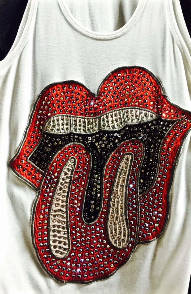 "John Pasche designed the ""Tongue and Lip Design"" logo in 1971 for The Rolling Stones. This is a tank top worn in performance on the Sticky Fingers tour."