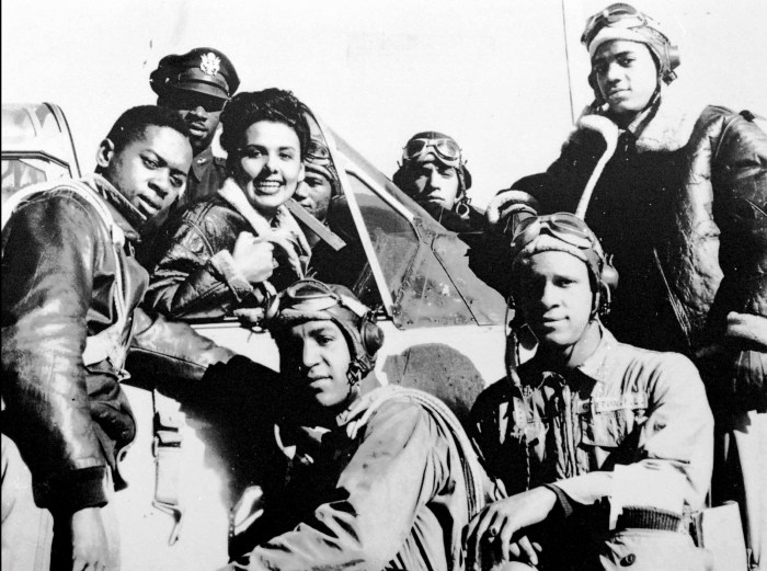 Singer and wartime pin-up girl Lena Horne, in cockpit, poses with cadets at the Tuskegee Airbase in Tuskegee, Alabama, in 1945. (AP Photo)