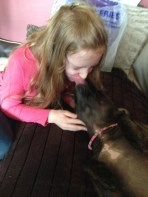 Tess giving Sally kisses after she made her a loom band collar