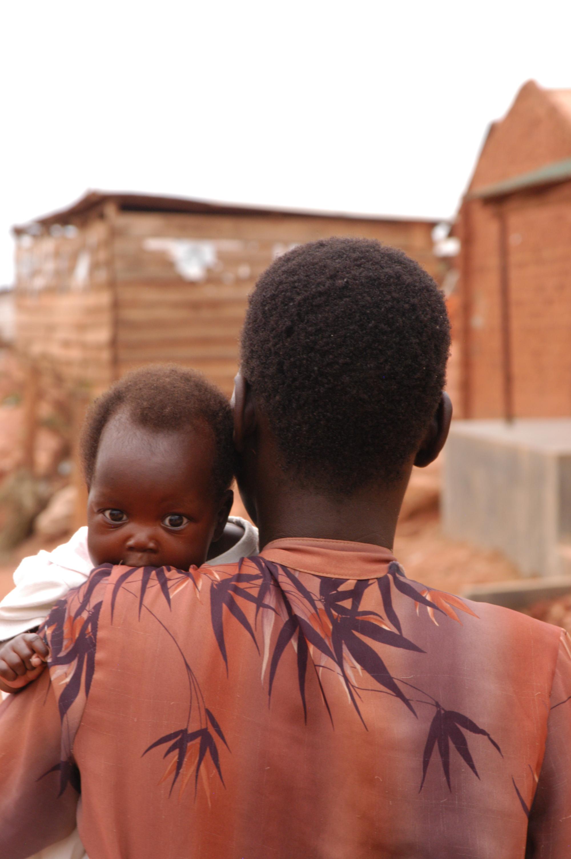 Acholi child with mother in Kampala, Uganda slum