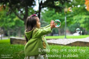 Little Girl with Bubbles Poster