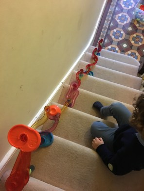 The Marbles run down the stairs