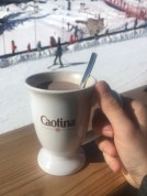 Enjoying a caotina hot chocolate while looking after the children