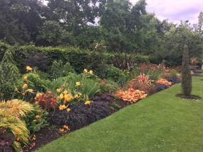 Colourful flowers mark the side of the pathway through Regent's Park