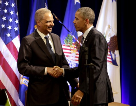 Barack Obama and U.S. Attorney General Eric Holder at Holder's portrait unveiling ceremony, Department of Justice, Washington DC—Feb. 27, 2015 (Rex Features via AP Images)