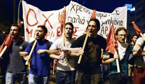 Protesters march over proposed austerity measures in Athens. (Louisa Gouliamaki/AFP/Getty)