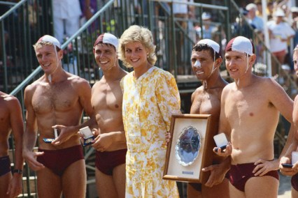31 Jan 1988, Near Sydney, New South Wales, Australia --- Princess Diana poses for a photograph with Lifeguards at Surf Carnival, a lifeguard competition in Australia. --- Image by © Tim Graham/CORBIS