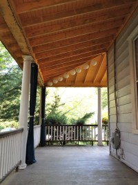 Victorian wrap around porch, porch ceiling, exposed beams