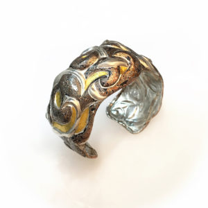 Mysteries Entwined, Eastern repousse patterned mokume gane cuff with kum boo