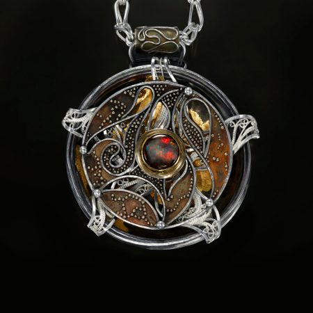 Relativity Navigator, Rotating Russian filigree, chased, granulation, and gilt pendant on a Roman chain by Victoria Lansford; photo by Pat Vasquez-Cunningham