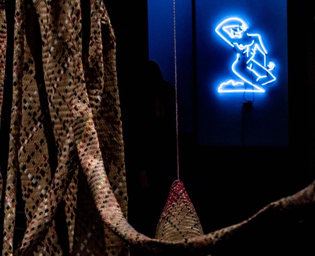 Street Ofelia by Mira Dancy in neon blue, with an untitled sculpture by Maria Nepomuceno in the foreground