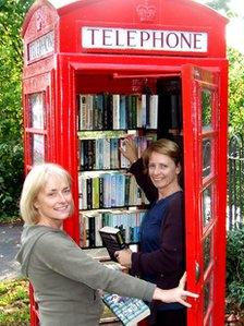 Public payphone in England convered to a book exchange. Photo by BBC