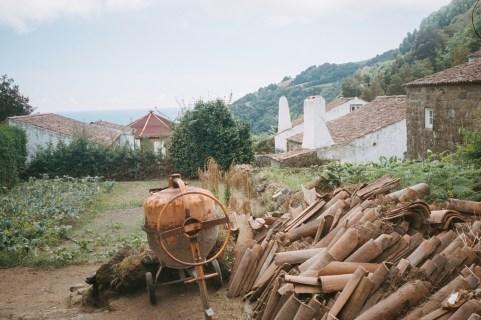 The terra cotta tiles sat drying next to the mortar mixer.