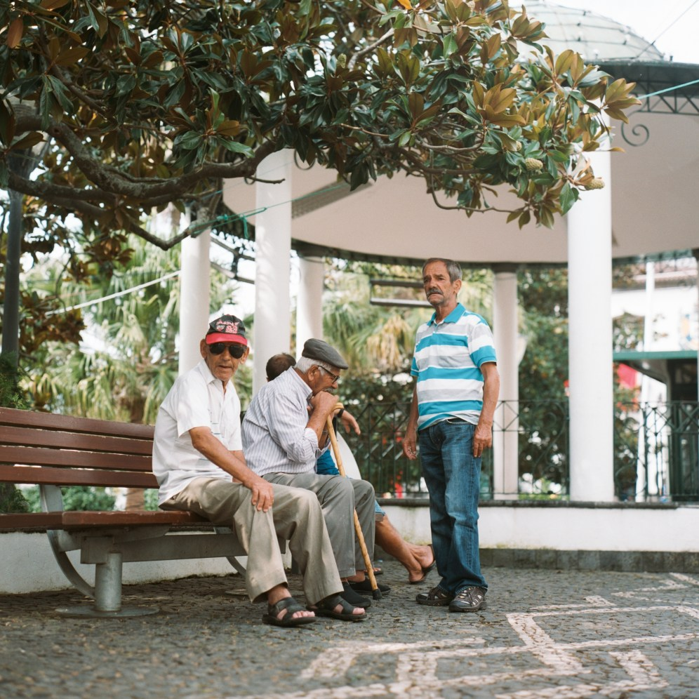 Men near the cafe in the village center.