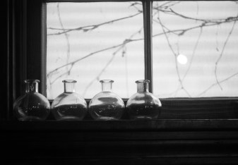 These bottles reside in the cafe near my home. I love shooting them.