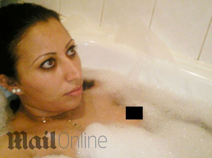 Hasna Aitboulahcen taking a bath. She does not have blonde hair.