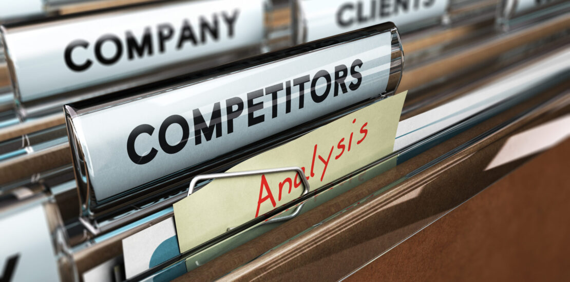 Close up on a file tab with the word competitors, focus on a yellow, note where it is hanwritten analysis, blur effect. Concept image for illustration of strategic management or business intelligence.