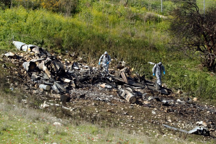 A picture taken in the northern Israeli Kibbutz of Harduf on February 10, 2018, shows the remains of an Israel F-16 that crashed after coming under fire by Syrian air defences during attacks against Iranian targets in the war-torn country. (AFP)