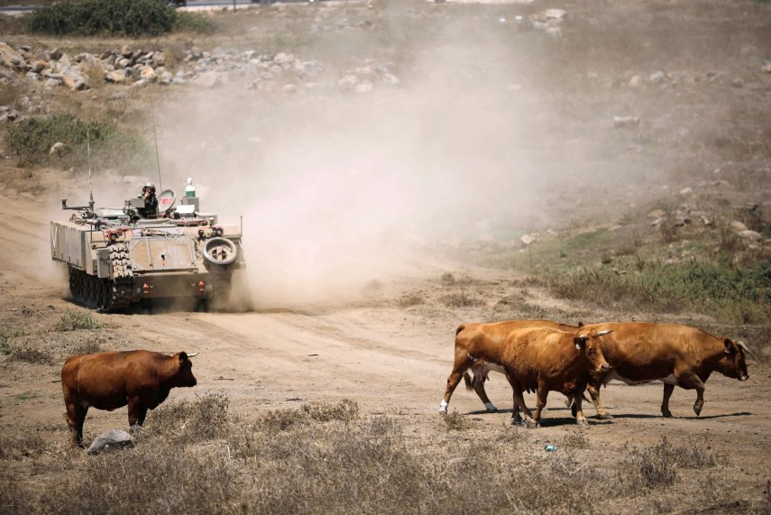 An Israeli soldier rides an armored vehicle in the Golan Heights on August 7, 2018. (Reuters)