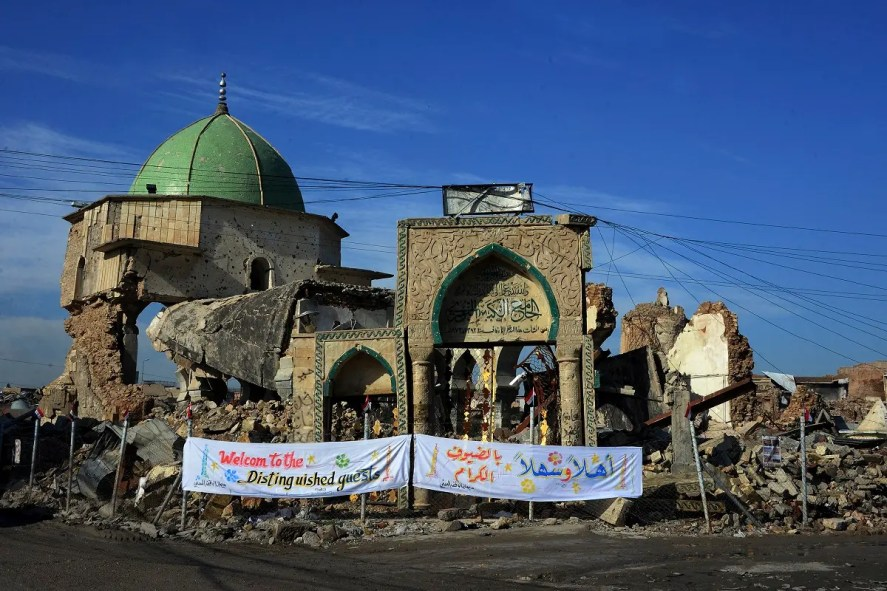 "The Great Mosque of al-Nuri and the remains of ""Al-Hadba"" leaning minaret in Mosul's war-ravaged Old City. (AFP)"