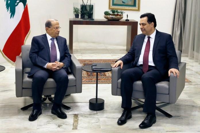 Hassan Diab and Michel Aoun at Baabda Palace on Tuesday